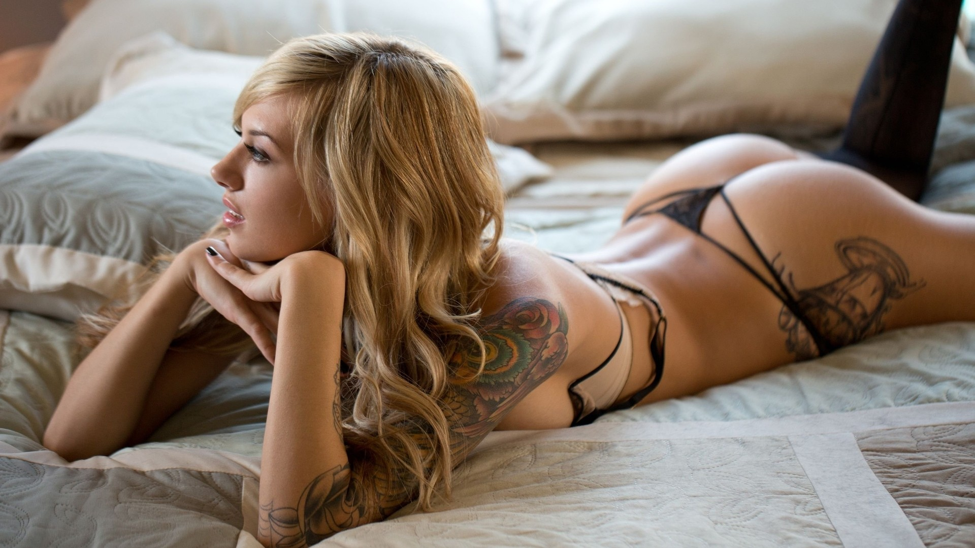 Tatooed beauty pounded from behind